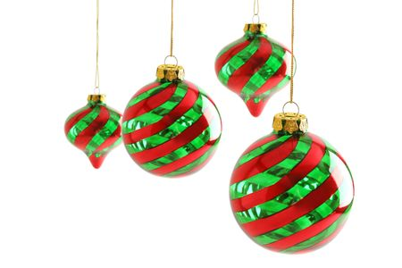 Four Christmas ornaments against a white background. Фото со стока