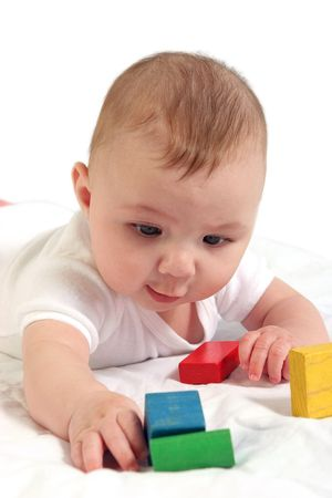 Close up shot of baby interested in colorful blocks. photo