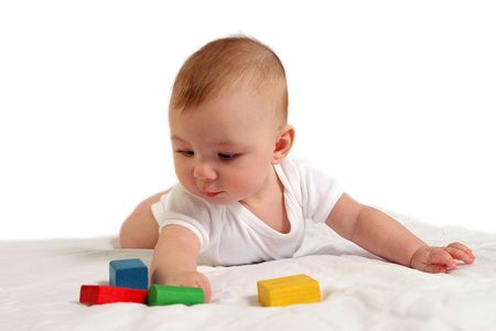 Full length shot of baby playing with colorful wooden blocks.