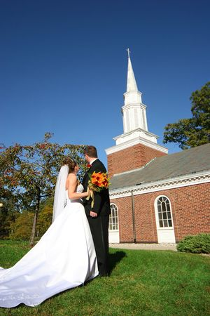 bride and groom outside the chapel Фото со стока