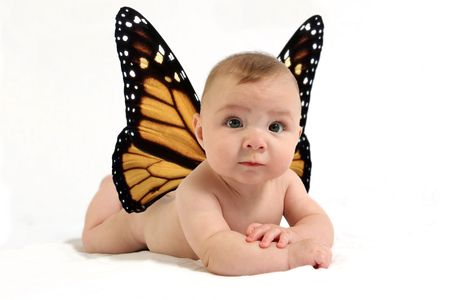 Naked baby with butterfly wings against white backdrop. Фото со стока - 605349