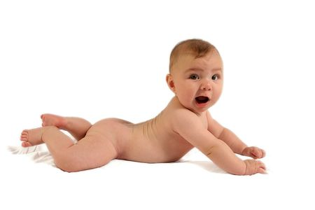 nude little girls: Surprised baby on belly against white backdrop.