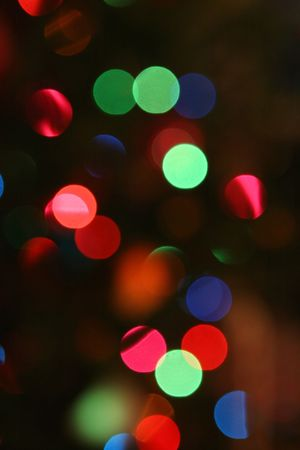 Brightly colored Christmas lights on a Christmas tree.