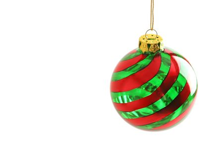 red and green swirl round Christmas ornament right photo