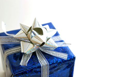 blue gift with silver ribbon and bow