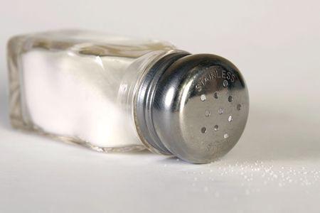 retain: Tipped salt shaker on side with spilled salt.