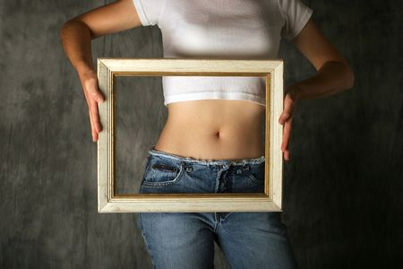 bmi: Womans torso with frame held in front of stomach.