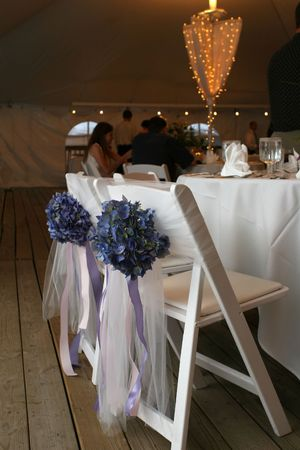 decorated bride and groom's seats at a wedding reception