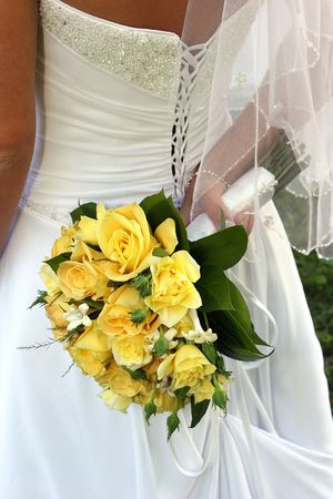 Detail of wedding dress back and yellow rose bouquet. Фото со стока - 615043