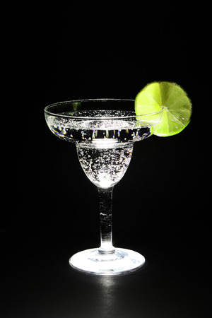 seltzer: lime and carbonated beverage in a margarita glass lit from underneath