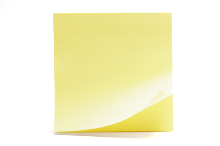 curled adhesive note on white background Фото со стока