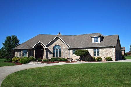 Nicely landscaped home. Фото со стока