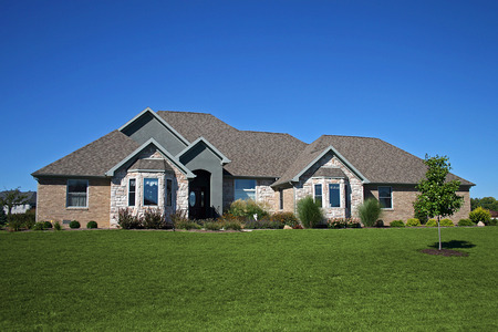 housing styles: brick ranch with stone accents