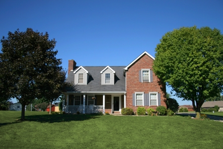 Nice two story brick home in suburb. Stock Photo
