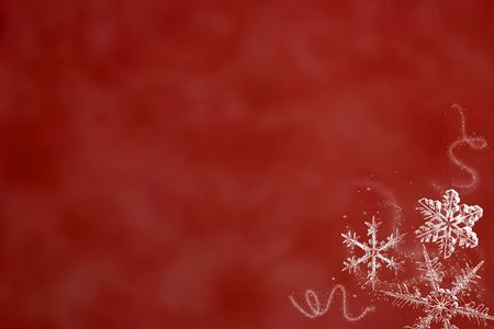 three white snowflakes on a simple red background
