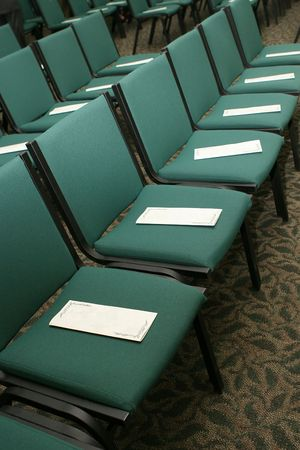 rows of chairs at a presentation