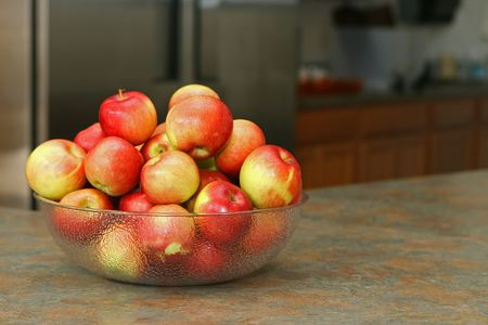 bowl of apples on slate countertop in kitchen