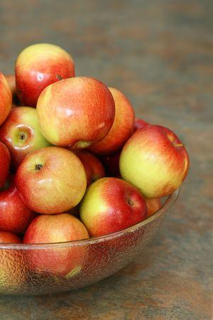 closeup of apple bowl on slate countertop Фото со стока