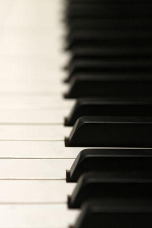 vertical piano keys, shallow DOF Фото со стока