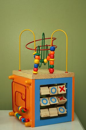 child's wooden toy against plain background
