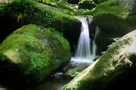 small waterfall between two boulders