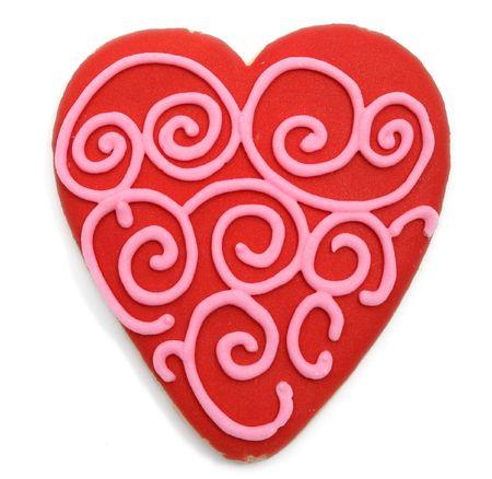 red valentine's cookie with pink swirls Фото со стока