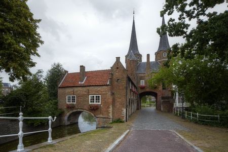 fense: The Oostpoort in Delft, the eastern gate to the old city centre Stock Photo