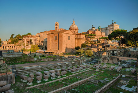 The Roman Forum is a rectangular forum (plaza) surrounded by the ruins of several important ancient government buildings at the center of the city of Rome. photo