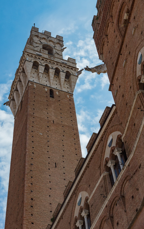 The Palazzo Pubblico (town hall) with Torre del Mangia is a palace in Siena, Tuscany, central Italy.