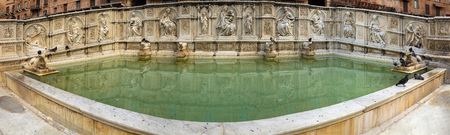 The Fonte Gaia is a monumental fountain located in the Piazza del Campo, opposite the Palazzo Pubblico in the center of Siena, Italy. 写真素材