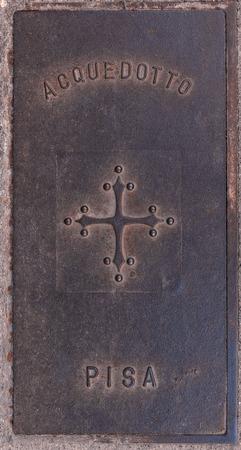 Old manhole cover. Pisa Tuscany Italy