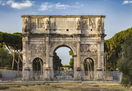 The Arch of Constantine is a triumphal arch in Rome, situated between the Colosseum and the Palatine Hill. Stock Photo