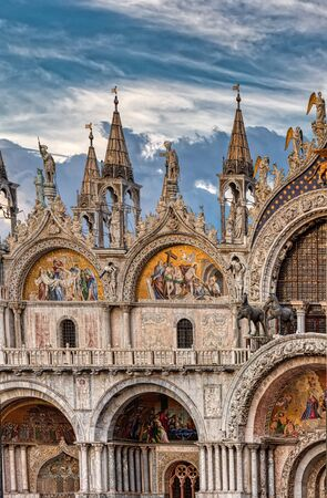Architectural fragment of basilica. Patriarchal Cathedral Basilica of Saint Mark is cathedral church of Roman Catholic Archdiocese of Venice, Italy. 写真素材