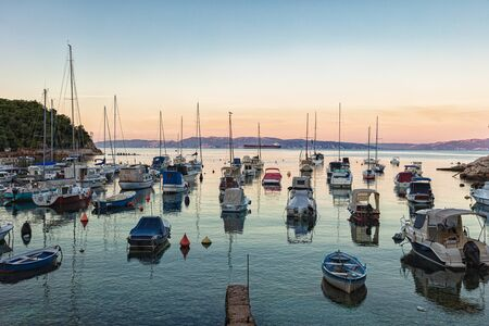 Bay and beach in Kostrena with yachts in the morning at sunrise.