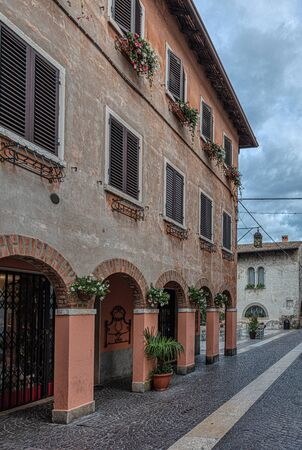 Lazise is a Medieval comune in the Province of Verona in the Italian region Veneto It is situated on the eastern shore of Lake Garda
