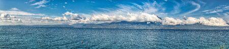 Garda Lake coast on a sunny day with beautiful clouds 版權商用圖片