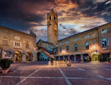Piazza Vecchia in Bergamo, Italy, with Contarini fountain, Palazzo della Ragione, Palazzo del Podesta and Campanone tower