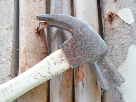 nautical structure: Drop the hammer on wood with nails stuck.