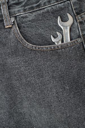 lug: black jeans pocket with chrome lug wrench