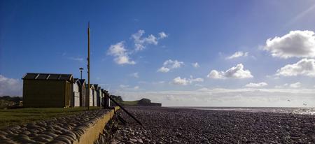 beach huts: Beach huts on Exmouth beach Stock Photo