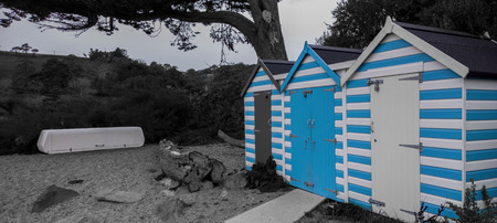 storage unit: Blackpool sands, Dartmouth, Devon, United Kingdom - October 12, 2014: 3 beach shacks at Blackpool Sands, Dartmouth, Devon, United Kingdom, showing a life guard storage unit next to 3 beach shacks