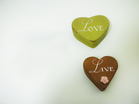 cream and green: Heart shaped tins on a cream  green background