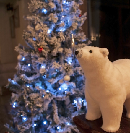 polar bear toy by a christmas tree photo