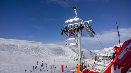 water skiers: Val Thorens, France -  January  15, 2015: Showing a people using a chair lift at Val Thorens Ski Resort