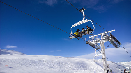 winter escape: Val Thorens, France -  January  15, 2015: Showing a people using a chair lift at Val Thorens Ski Resort