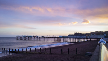 amusment: Teignmouth pier at sunset, with a red sky