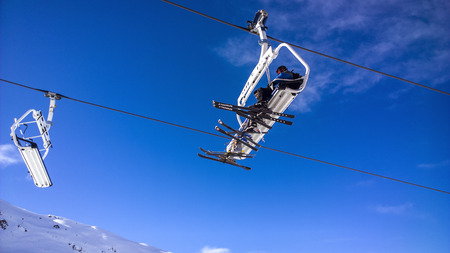 water skiers: Showing a people using a chair lift at Val Thorens Ski Resort Stock Photo