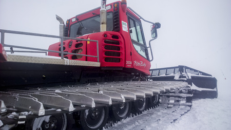winter escape: Val Thorens, France -  January  16, 2015: Showing the side of a piste bully at Val Thorens Ski Resort. Editorial