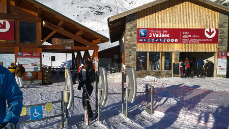 water skiers: Val Thorens, France -  January  12, 2015: Showing one of the slopes at Val Thorens Ski Resort, with skiers queueing for a ski lift Editorial