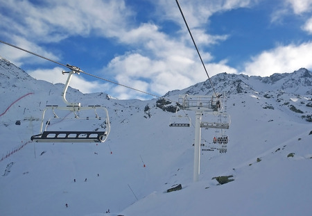water skiers: Val Thorens, France -  January  15, 2015: Showing a chair lift at Val Thorens Ski Resort